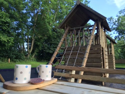 Garden Play Fort and circular picnic table with back rests