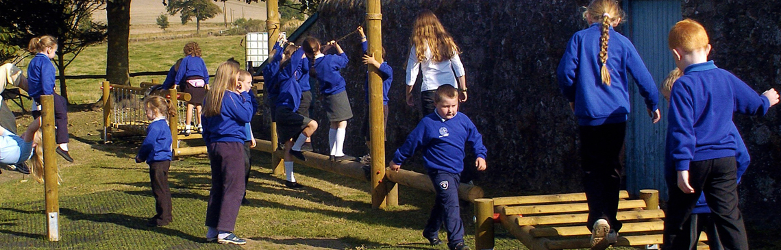 School children playing on activity and agility trail