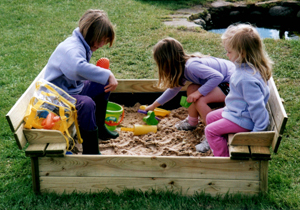 Sandpit with children playing in the sand
