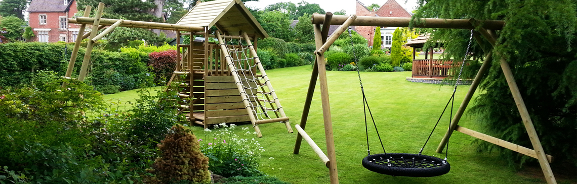 Garden play fort and family basket swing in lovely English garden