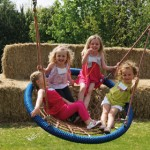 Children in basket swing at farm park
