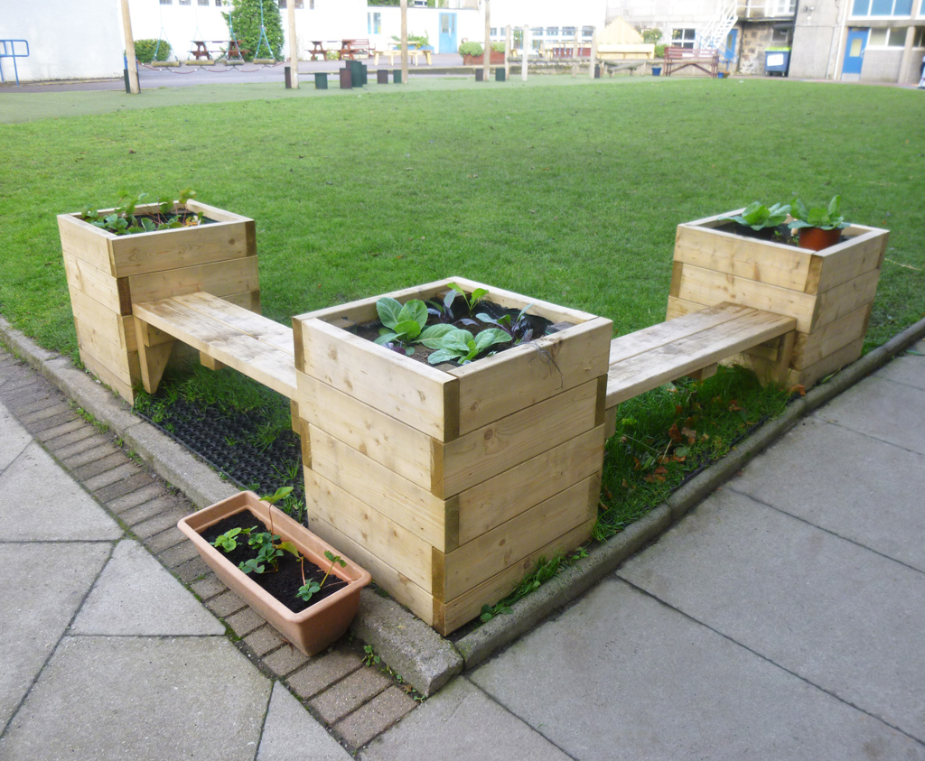 Bench and planter combination caledonia play for Outdoor seating