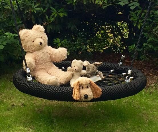 Black basket swing with teddies