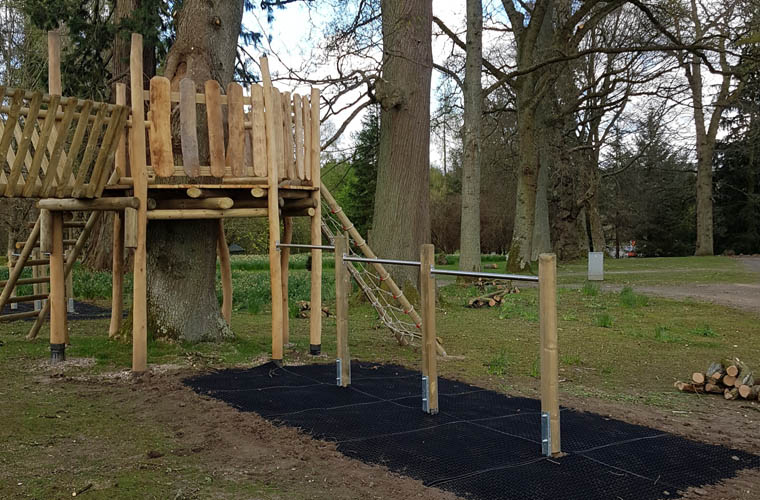 Triple tumbling bar extension on tree deck with grass safety mats as safety surfacing