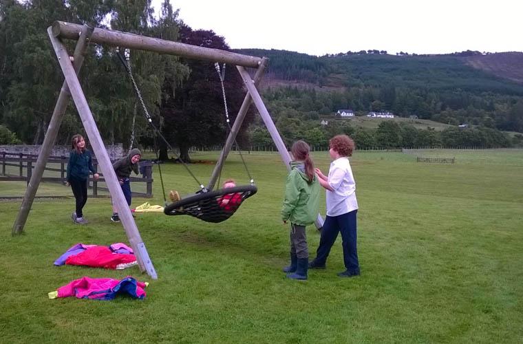 Children enjoying the Basket Swing
