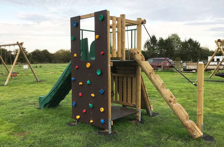 Activity tower showing the Climbing Wall and Jungle Ladder